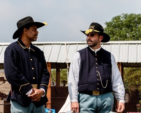 Two costumed Buffalo Soldiers talk