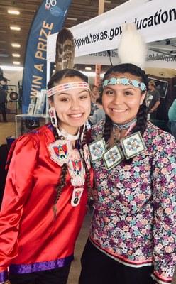 two Native American girls wearing beaded headbands