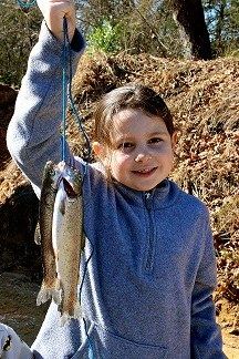 Young girl holding Rainbow Trout