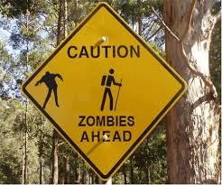 """Sign that says """"Caution, zombies ahead."""""""