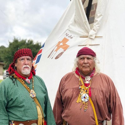 Two men dressed in Lipan Apache clothing