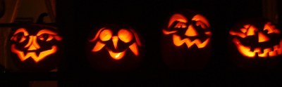Jack-o-lanterns glowing at night.