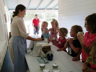 Children making butter at LBJ State Park