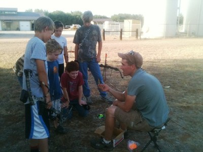 caption:Kids participating at LBJ Summer Archery Clinic