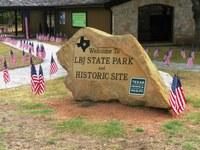 Patriotic flag and rock at LBJ State Park