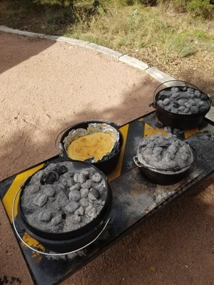 dutch oven pots covered with coals