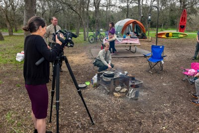 TPWD staff reading a camp site for a video shoot