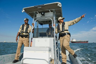 TPWD Game Wardens driving boat