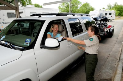 State Park staff talking with guest in a vehicle