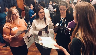 Recruiter talking with students