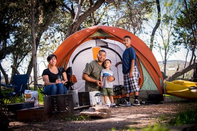 Family posed in front of small tent