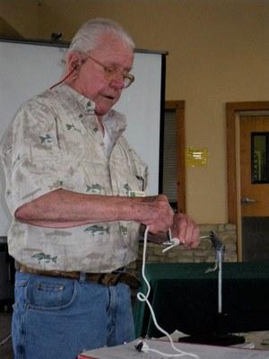 Dr. Guy Harrison demonstrating fly tying