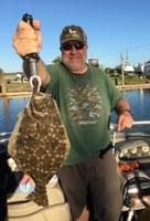 angler with flounder fish