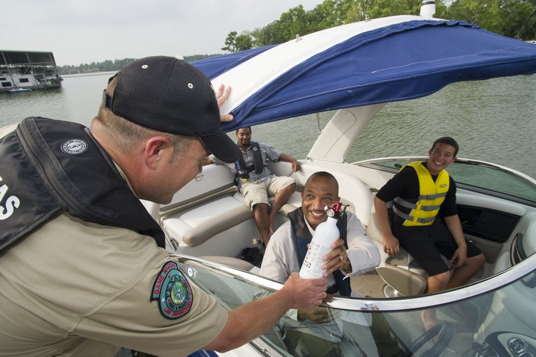 Game Warden does a boating safety check