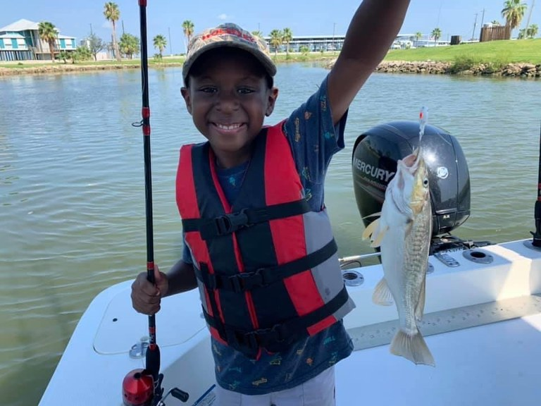 Young fisherman with a fish