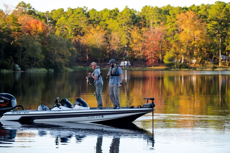 Two fishermen on a bass boat