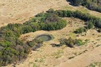 Another aerial view of land, woods and water