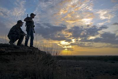 Hunters at sunset