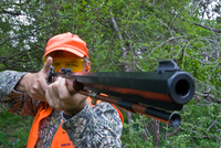 hunter aiming muzzleloader
