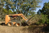 Clearing brush with bulldozer