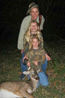 mom and daughters with harvested deer