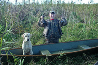 Young hunter with harvested ducks and dog