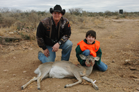 Youth Hunter and adult with deer