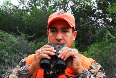 hunter lowers binoculars