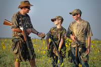 Adult with young dove hunters