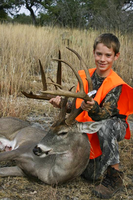 Young hunter with harvested buck