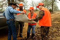 Hunters looking at map with landowner