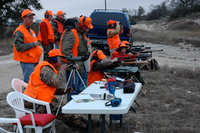 Adults supervising youth hunters target practice