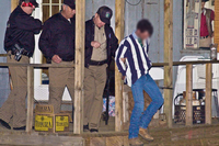 Game Wardens arresting a man