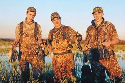 Young hunters with harvested waterfowl