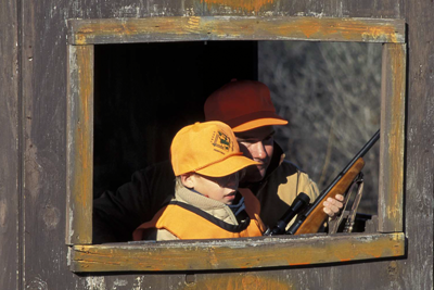 Youth hunter in blind