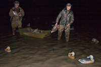 Hunters setting out decoys in pre-dawn hours
