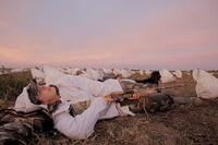 Goose hunter lying in rag spread