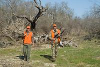 Hunters walking in field