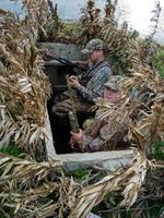 Hunters inside pit blind