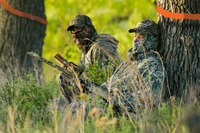 hunters in camo calling turkey