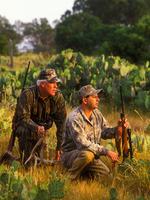 hunters kneeling and watching