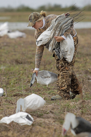 Hunter picking up rag decoys
