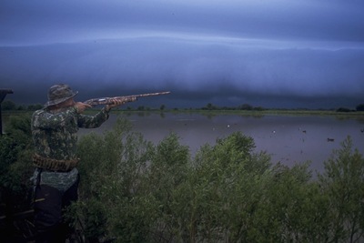 Storm rolling in on waterfowl hunter