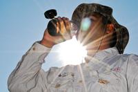 Hunter drinking water in hot sun