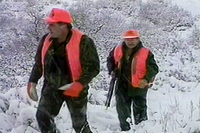 Hunters walking in the snow