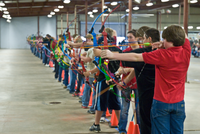 row of young archers drawing bows
