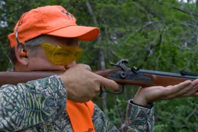 shooter firing muzzleloader