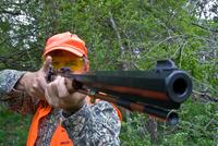 hunter aiming muzzleloader