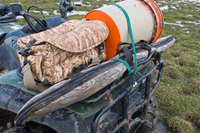 secured firearm on ATV