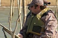 sloe-up of hunter wearing PFD